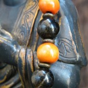 Detail of obsidian and wooden beads