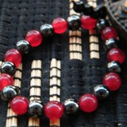 six small hematite beads to tie off the ends