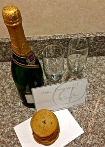 Champagne with glasses AND fresh baked cookies.