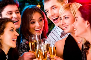 People gather at a holiday party, part of being your own matchmaker during the holidays