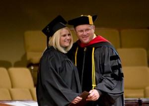 kristine-with-diploma