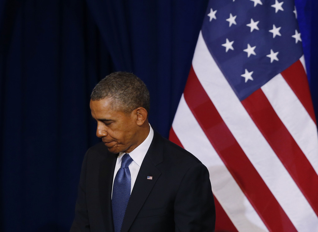 President Barack Obama turns to leave the stage after he spoke about National Security Agency (NSA) surveillance, Friday, Jan. 17, 2014, at the Justice ...