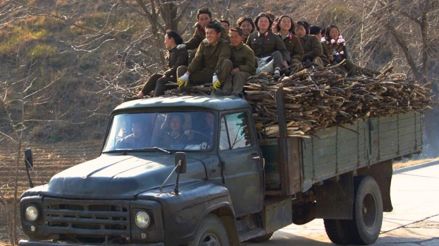 North Korean soldiers hauling firewood
