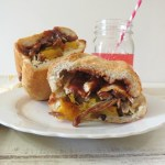 Grilled Tri Tip with Roasted Peppers and Onions Sandwich