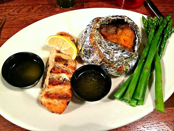 Whole30 approved dinner at Texas Steakhouse. Salmon, sweet potato and asparagus with clarified butter.