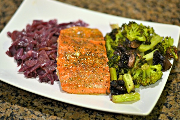 Baked salmon with braised red cabbage and roasted broccoli and mushrooms