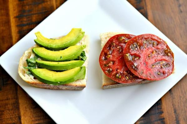 Heirloom tomato sandwich with sliced avocado, basil and Dukes mayo on sourdough.