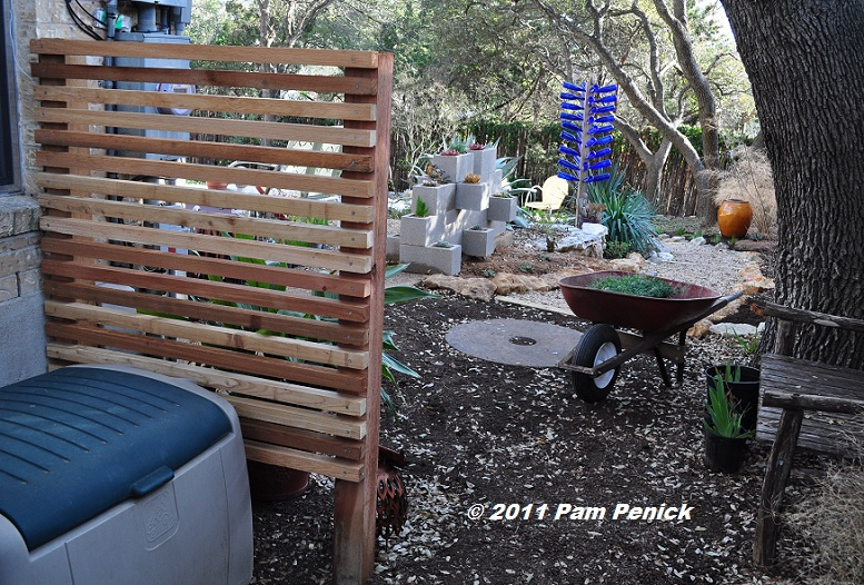 making a wood screen to hide the garden work zone