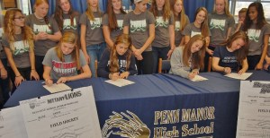 From left, Emma Evarts, Cassie Kline, Brionna Kline and Carolyn Stoss sign letters of intent to play field hockey in college.