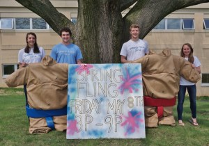 Spring Fling coordinators, from left, Morgan Edwards, Nick Kirk, Will Forrey and Hannah Willig display the sumo suits that will be featured at PMHS's Spring Fling Friday, May 8.