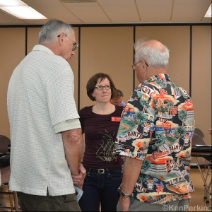 Tara Murray of the APRL tackles a tough question from Jim Giacomazzi, past president of the Sequoia Stamp Club, and club member Jim Mosso.  Photo byKen Perkins