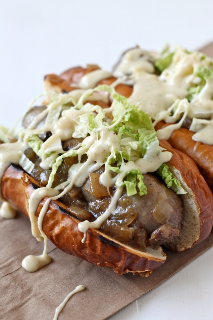 Beer Braised Brats with Gruyere Beer Cheese Sauce