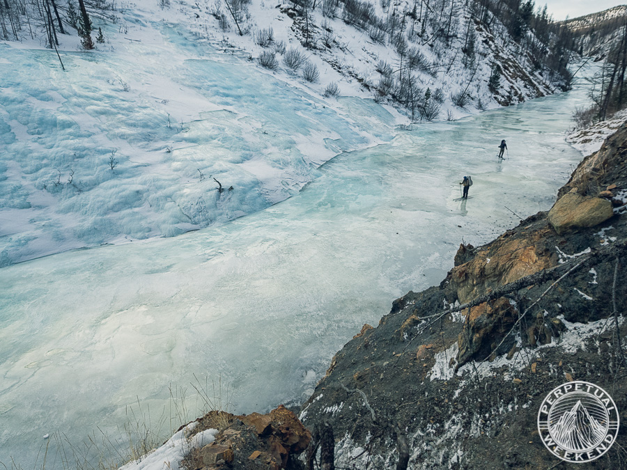 Forrest McCarthy and Gregg Treinish ski down aufeis over a frozen streambed