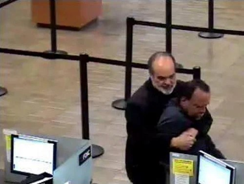 Pultizer Prize Winning Photographer Foils Bank Robbery with Bear Hug pulitzerbearhug
