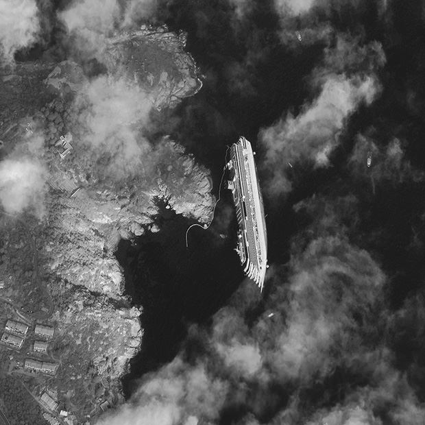 Photo of the Costa Concordia Shipwreck Captured from Space satellite mini