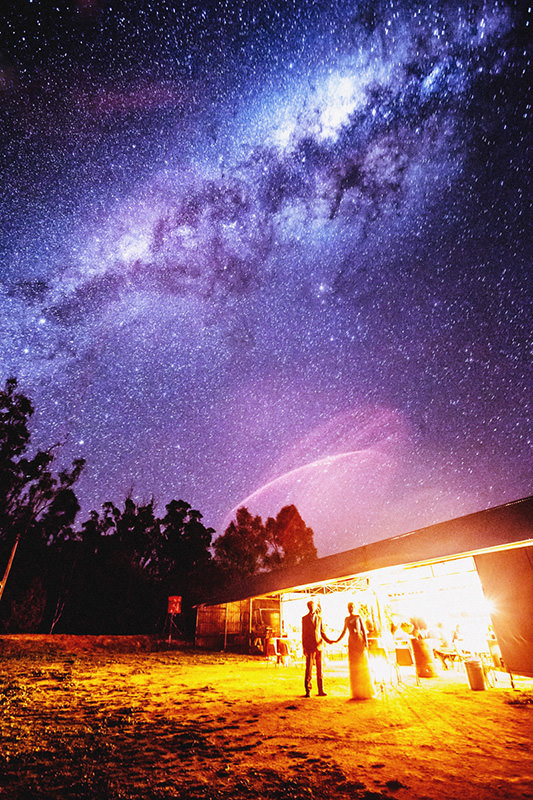 Spectacular Wedding Photo Showing the Milky Way Floating Overhead weddingstars mini