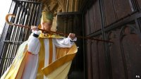 Behold, Archbishop Justin stands at the door and knocks