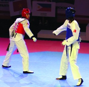 Fourteen year old Abigail Valdez (red gear) wins a bronze medal for the Philippines in the Female Flyweight Division