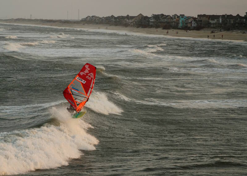 Phil Soltysiak CAN 9 windsurfing freestyle board wave riding at the Avon Pier in Cape Hatteras, North Carolina - Photo by Adam Wojtkowiak