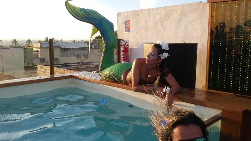 Mermaids at Hurricane Hotel sunset party.
