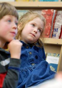 "Jack Milton/Staff Photographer: Eileen Porterfield, 6, listens to Phil Hoose, author of ""Hey Little Ant,"" talks with her first and second grade classmates at Friends School of Portland"