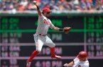 Freddy Galvis jumps in the air in an effort to turn a double play in this afternoon's ballgame.