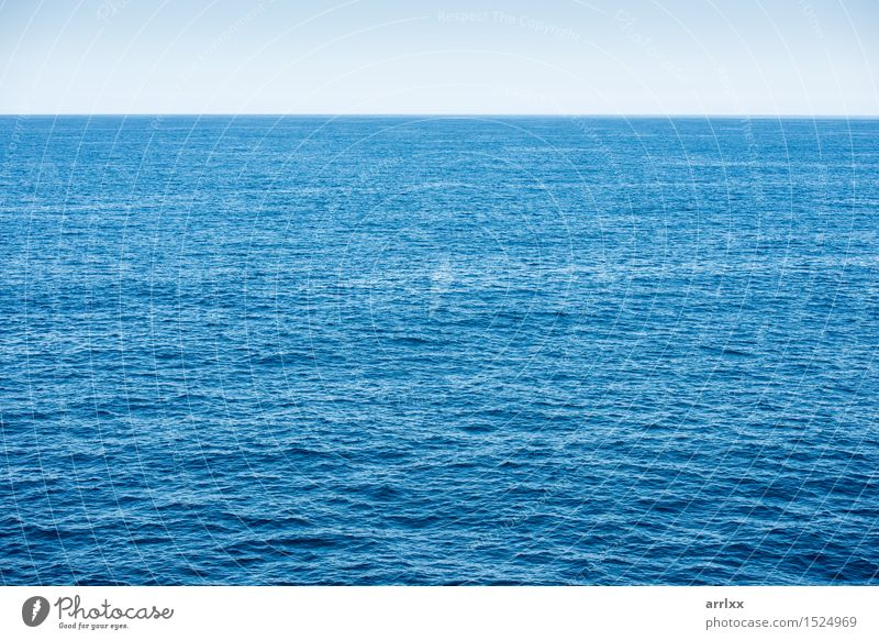 Blue ocean background with blue sky - a Royalty Free Stock Photo