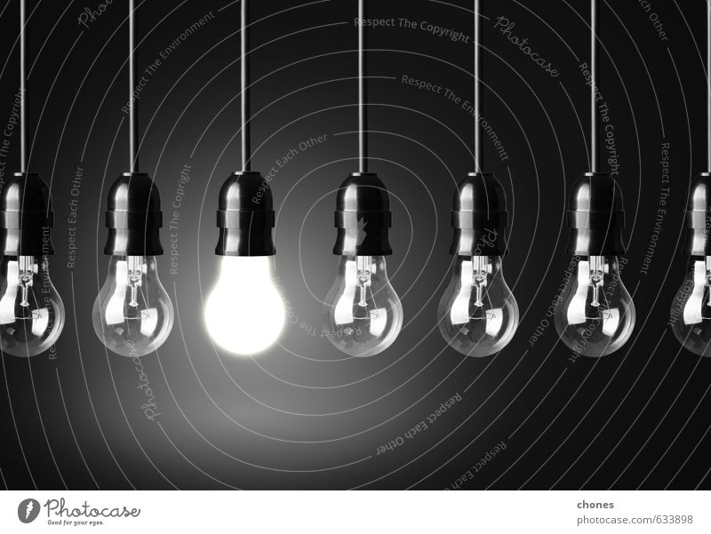 Idea concept on black background - a Royalty Free Stock Photo from
