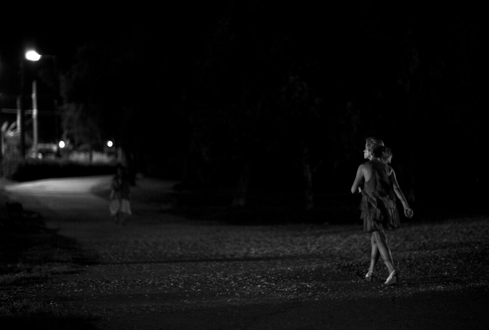 Girl Looking At Moon Wallpaper Nasos Zovoilis A Woman Walking In The Dark