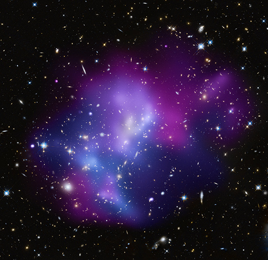 This composite image shows the massive galaxy cluster MACSJ0717.5+3745