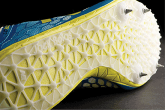 The sole of a running shoe with a custom spike plate designed based on an individual runner's data and manufactured with plastic laser sintering from EOS.