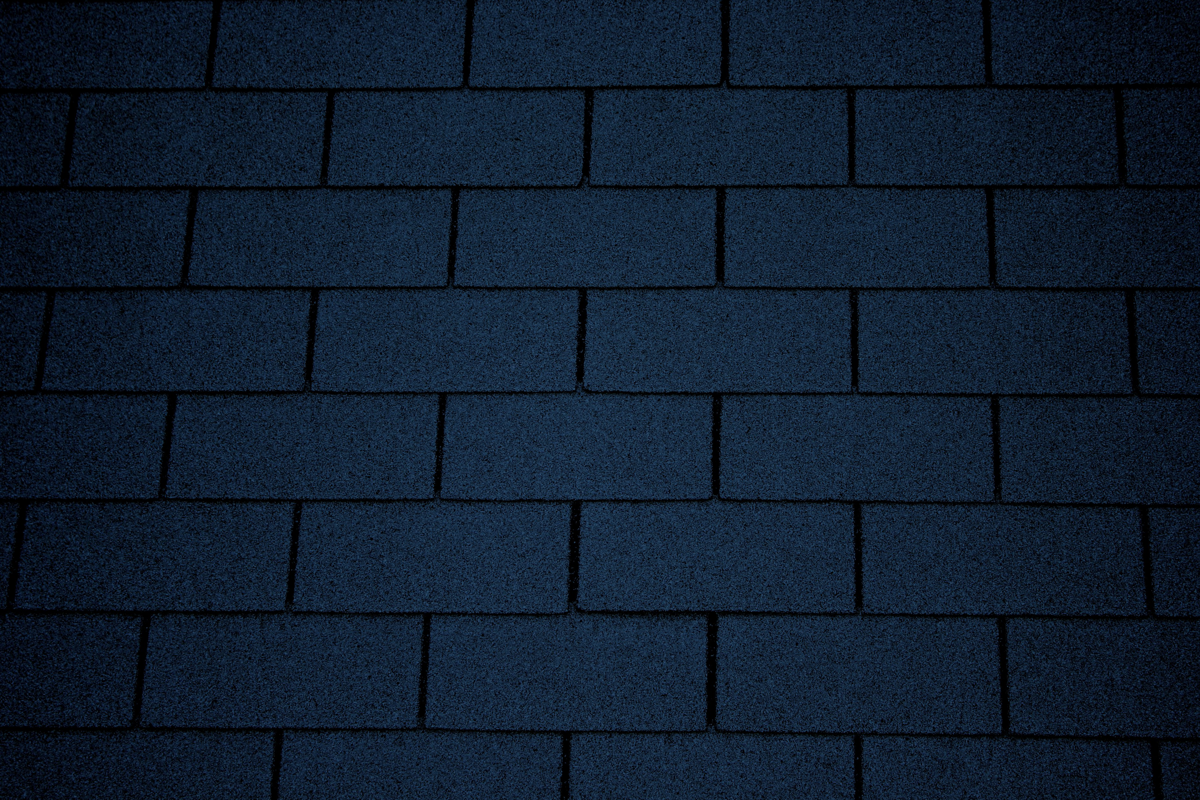 Dark blue asphalt roof shingles texture