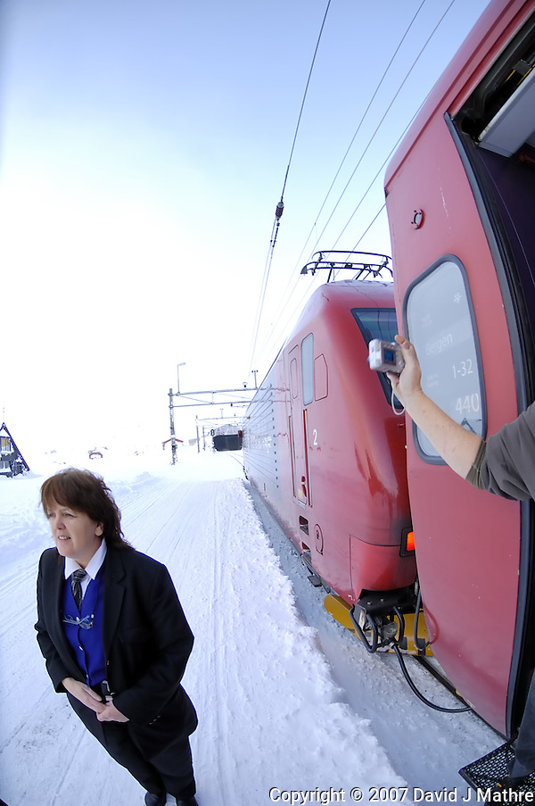 Conductor on the Bergen Railroad at Finse, Norway. Image taken with a Nikon D2xs and 10.5 mm f/2.8 Fisheye lens (ISO 100, 10.5 mm, f/4, 1/60 sec) (David J. Mathre)