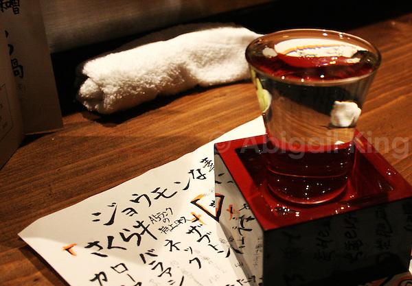 Sake glass in sake box on sake menu