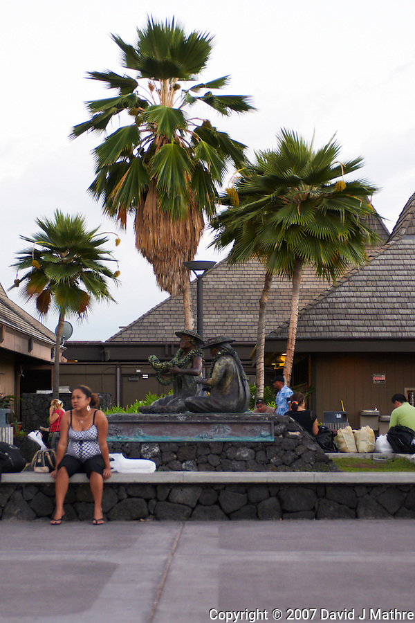"""Kona International Airport Waiting Area. Bronze of """"The Lei Makers"""" Image taken with a Nikon D300 and 28-70 mm f/2.8 lens (ISO 560, 45 mm, f/2.8, 1/60 sec). (David J Mathre)"""