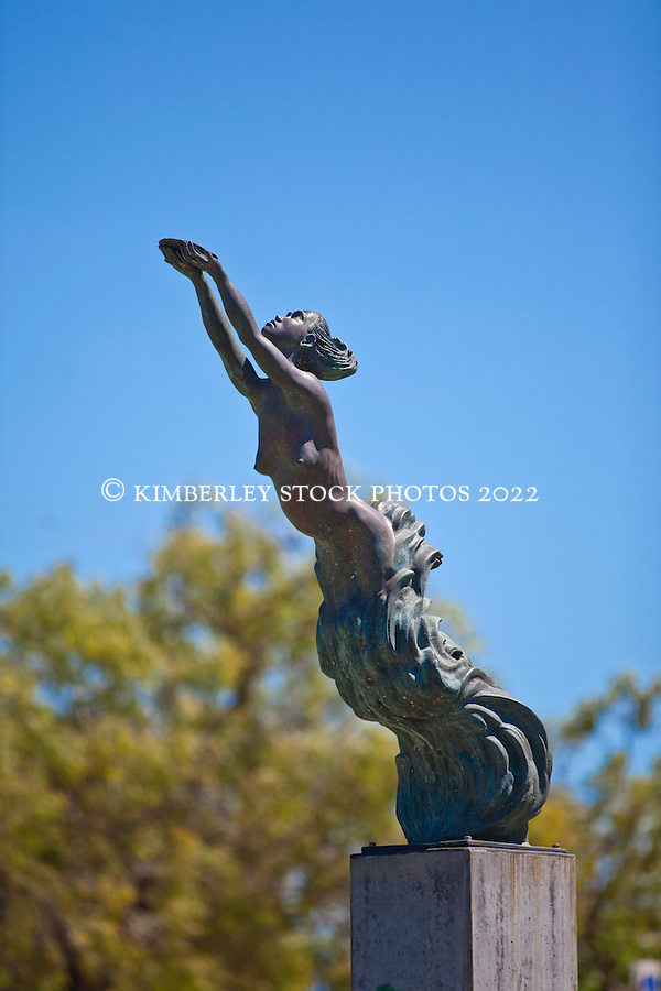 "The beautiful statue of a female pearl diver on the Conti Foreshore represents a pregnant Aboriginal diver.  The statue encapsulates the contribution of women to the pearling industry.  The inscription reads ""And precious the tear as that rain from the sky, Which turns into pearls as it falls in the sea"" (Thomas Moore).  The location represents the  place where families of indentured labourers were houses, awaiting their of their loved ones at the end of the neap tides...The Conti foreshore provided an open view of the bay in the days before the luggers were equipped with radios. (Annabelle Sandes/© Annabelle Sandes 