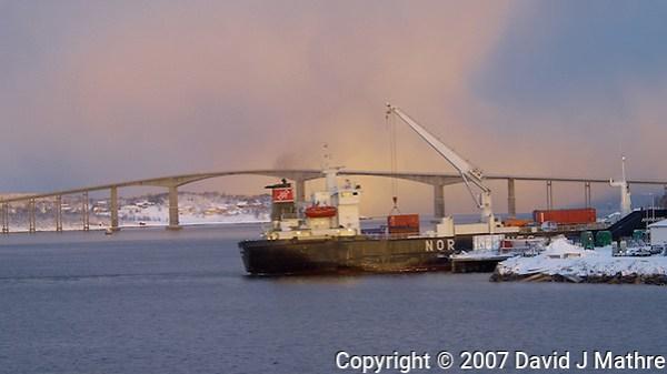 Freighter Loading and Gisund Bridge (Gisundbrua) in Finnsnes Norway. Image taken with a Nikon D2xs and 80-400 mm VR lens (ISO 200, 80 mm, f/4.5, 1/40 sec) (David J Mathre)