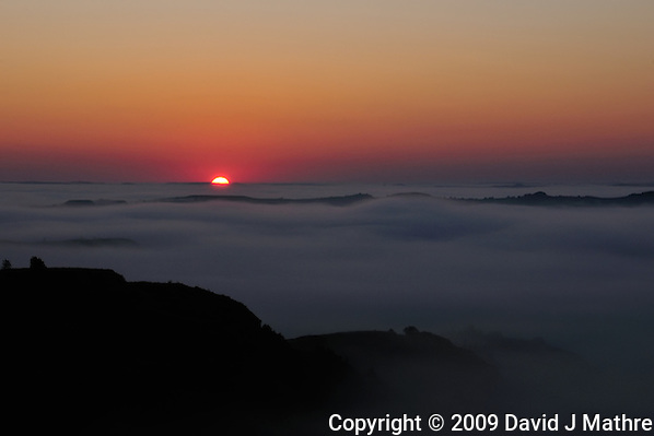 Sunrise Over a Fog Covered Missouri River at Theodore Roosevelt National Park in North Dakota. Image taken with a Nikon D300 and 18-200 mm VR lens (ISO 200, 60 mm, f/22, 1/100 sec). (David J. Mathre)