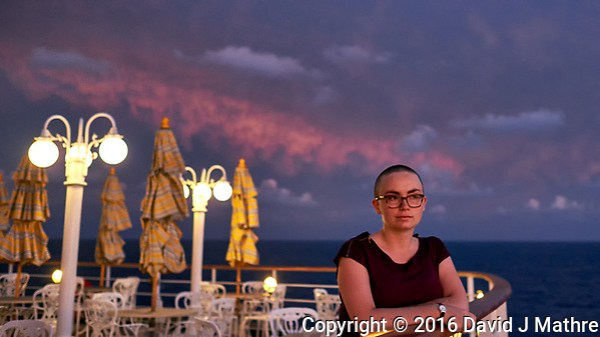 Maria at dawn, only a few days since the hair was cut on board the MV World Odyssey. Day 65 of 103 of the Semester at Sea Spring 2016 Voyage at sea between Mauritius and South Africa. Image taken with a Fuji X-T1 camera and 23 mm f/1.4 lens (ISO 800, 23 mm, f/2, 1/60 sec) (David J Mathre)
