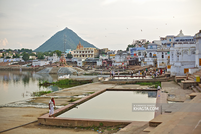 Ghats around Pushkar Lake, Rajasthan.  Holy town of Pushkar, 14 kms from Ajmer is famous for its annual camel fair held in the autumn. With a scared lake, old temples and roof top restaurants, its a major tourist attraction attracting mostly foreign tourists. Pushkar also offers a great variety of delicious food. The town that got famous by its colorful camel fair is a very old religious place for Hindu pilgrims. (Himanshu Khagta)