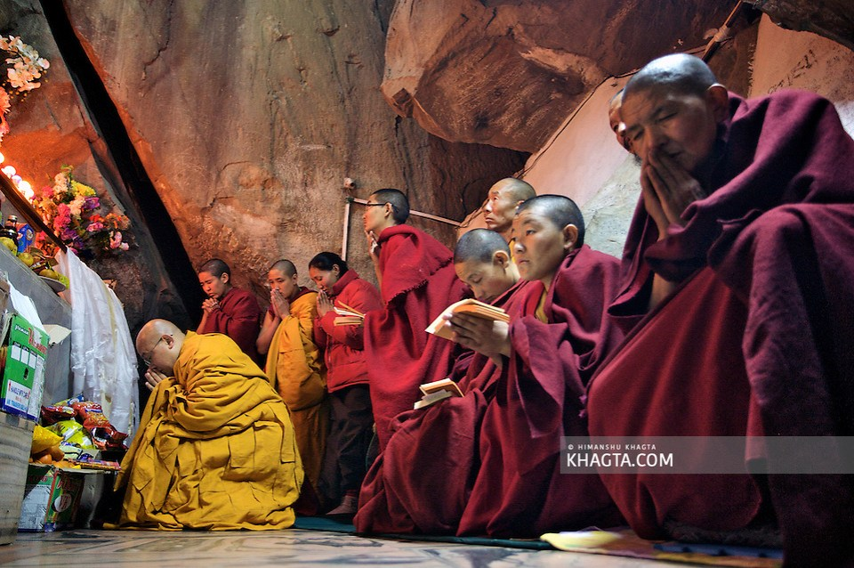 Buddhist Nuns praying with a monk in the cave of Guru Padmasambhava in Rewalsar, Mandi, Himachal Pradesh, India (Himanshu Khagta)
