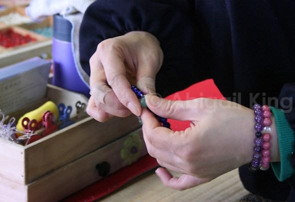 Threading Buddhist Prayer Beads in Matsushima Bay, near Sendai, Japan
