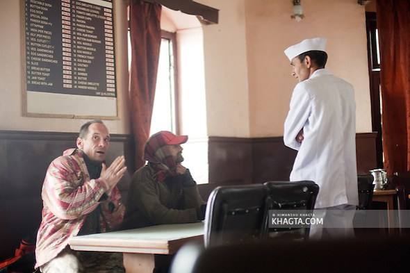A waiter takes the order of the customers in a cold winter morning of Shimla. (Himanshu Khagta)