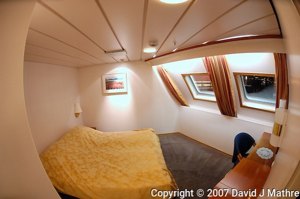 Fisheye View of Erik's Stateroom on the M/S Kong Harald. Image taken with a Nikon Dxs and 10.5 mm f/2.8 fisheye lens (ISO 400, 10.5 mm, f/2.8, 1/10 sec) (David J. Mathre)