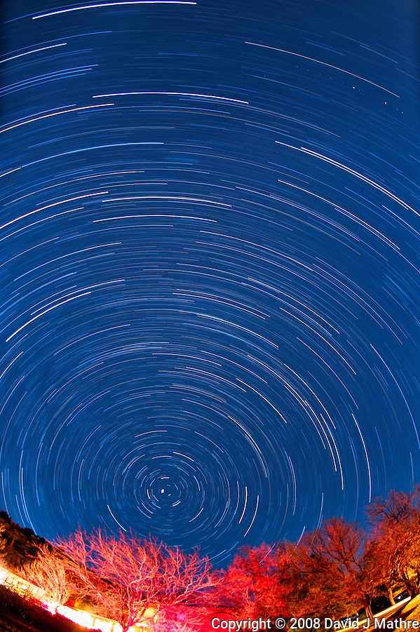 Winter night sky looking north at Kelley's Place near Cortez, Colorado. Composite of four images taken with a Nikon D3 camera and 16 mm f/2.8 fisheye lens (ISO 200, 16 mm, f/2.8, 30 min). (David J Mathre)