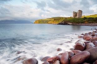 Minard Castle on bluff overlooking Dingle Bay, Dingle Peninsula, Republic of Ireland
