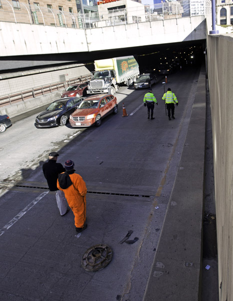 02/12/2016-Boston,MA. State Police investigators are seen Route 93 Southbound, inside the O'Neill Tunnel, near the spot where a manhole resided before coming loose and eventually flying into a car's windshield killing a woman during Friday morning's commute.