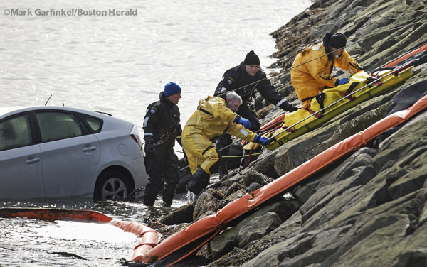 03/05/16-Boston,MA First responders work to lift a stretcher carrying the body of a person at the scene of this car in the water, near the JFK Library and UMASS Boston. Staff photo by Mark Garfinkel