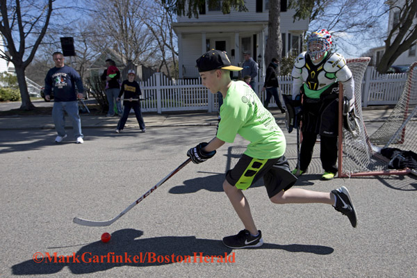 04/09/2016-Boston,MA. Seamus Reardon competes in the annual Shamrock Shootout Street Hockey Tournament on Temple St. in the West Roxbury section of the city, Saturday morning. Staff photo by Mark Garfinkel