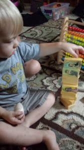 Stacking his awesome Saint blocks is a quiet activity, but it's not quite the same thing as praying.